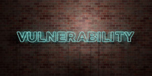 VULNERABILITY - fluorescent Neon tube Sign on brickwork - Front view - 3D rendered royalty free stock picture.