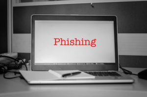 Red word phishing display on laptop screen.Black and white image and selective focus