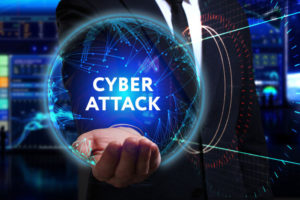 man working in the field of the future, he sees the inscription: cyber attack