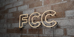 FCC - Glowing Neon Sign on stonework wall - 3D rendered royalty free stock illustration