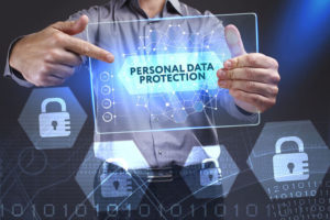man showing a word in a virtual tablet of the future: Personal data protection