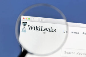 Closeup of WikiLeaks website website under a magnifying glass. WikiLeaks is an international non-profit organisation that publishes secret information