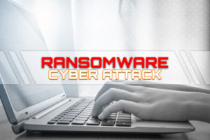 Ransomware Cyber Attack with hand on keyboard