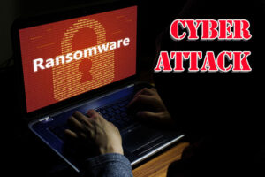 Ransomware attack on desktop screen notebook red background