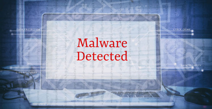 word MALWARE DETECTED display on laptop