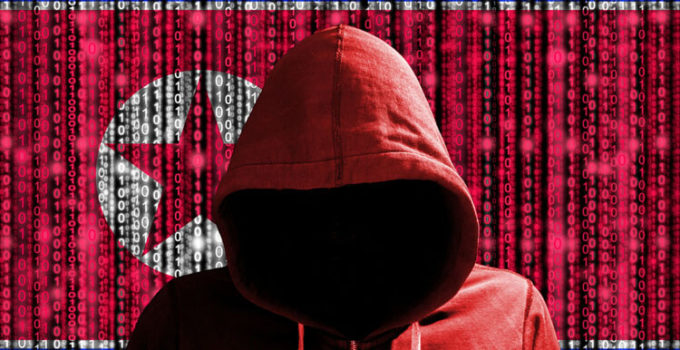 Hacker in a dark red hoody in front of a digital korean flag