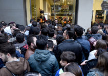 People waiting outside department store