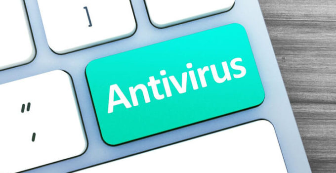 Green button with antivirus word on the keyboard close-up