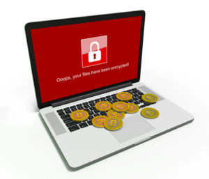 WannaCry ransomware cyber attack along with Bitcoins on the laptop
