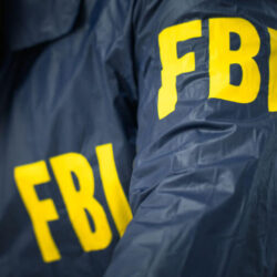 FBI agent in his office in uniform