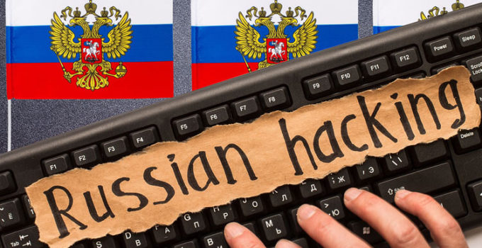 Russian hacking, inscription on torn paper sheet. Russia hacking concept