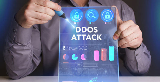 man working on a virtual screen of the future and sees the inscription: Ddos attack