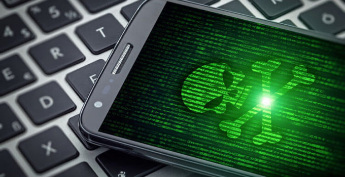 skull of death on smart phone screen. Hacked mobile phone on tablet computer