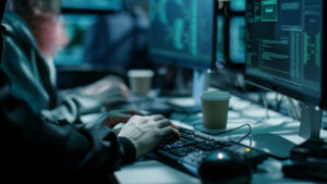 Close-up Shot of Hacker using Keyboard