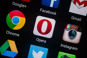 Closeup photo of Opera icon on mobile phone screen.