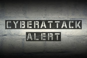 cyberattack alert stencil print on the grunge brick wall with gradient effect