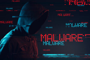 Malware concept with faceless hooded male person, low key red and blue lit image and digital glitch effect
