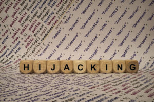 hijacking - cube with letters and words from the computer, software, internet categories, wooden cubes