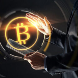 man with transparent tablet pc computer and virtual bitcoin symbol hologram over black background