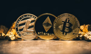 Golden cryptocurrencys Bitcoin, Ethereum, Litecoin and mound of gold
