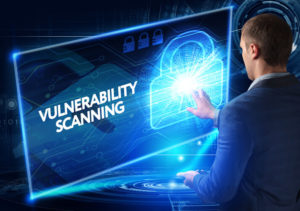 Man working on the tablet of the future, select on the virtual display: VULNERABILITY SCANNING