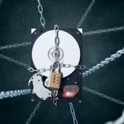 Chained hard disc drive with combination padlock. Conception of data security