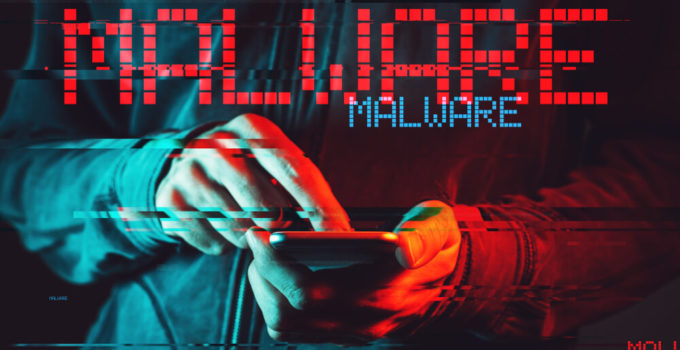 Malware concept with male person using smartphone, low key red and blue lit image and digital glitch effect