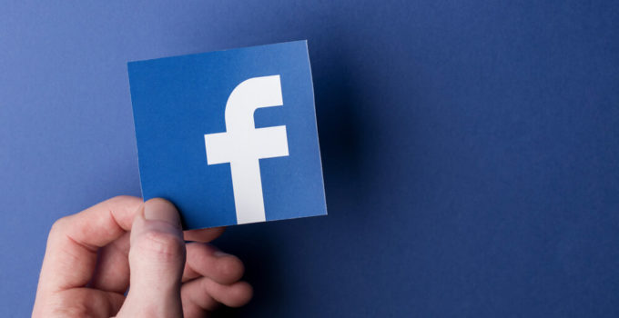 Facebook logo printed onto paper. Facebook is a popular social media service founded in 2004