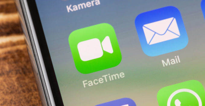 lose up to facetime app on the screen of an iPhone X with personalized background