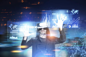 Hacker guy in a black hoodie and VR glasses standing against a blue cityscape with glowing graphs and schemes